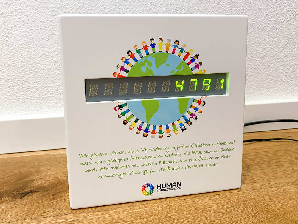 Human Connection-Uhr - grüne LED